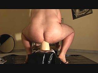Fucking ass hole with black huge dildo