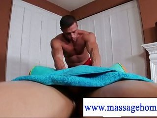 Masseuse putting oil on a penis
