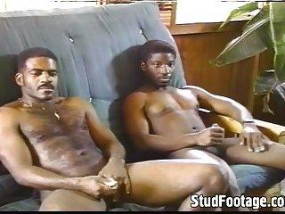 Ebony gay men fuck on the couch