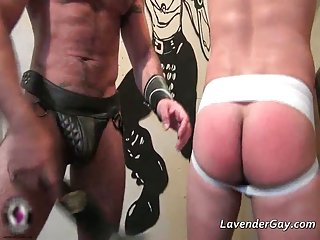 Kinky BDSM gay scene with spanking and cock sucking before butt