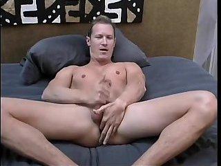 Hunk jerks off his dick